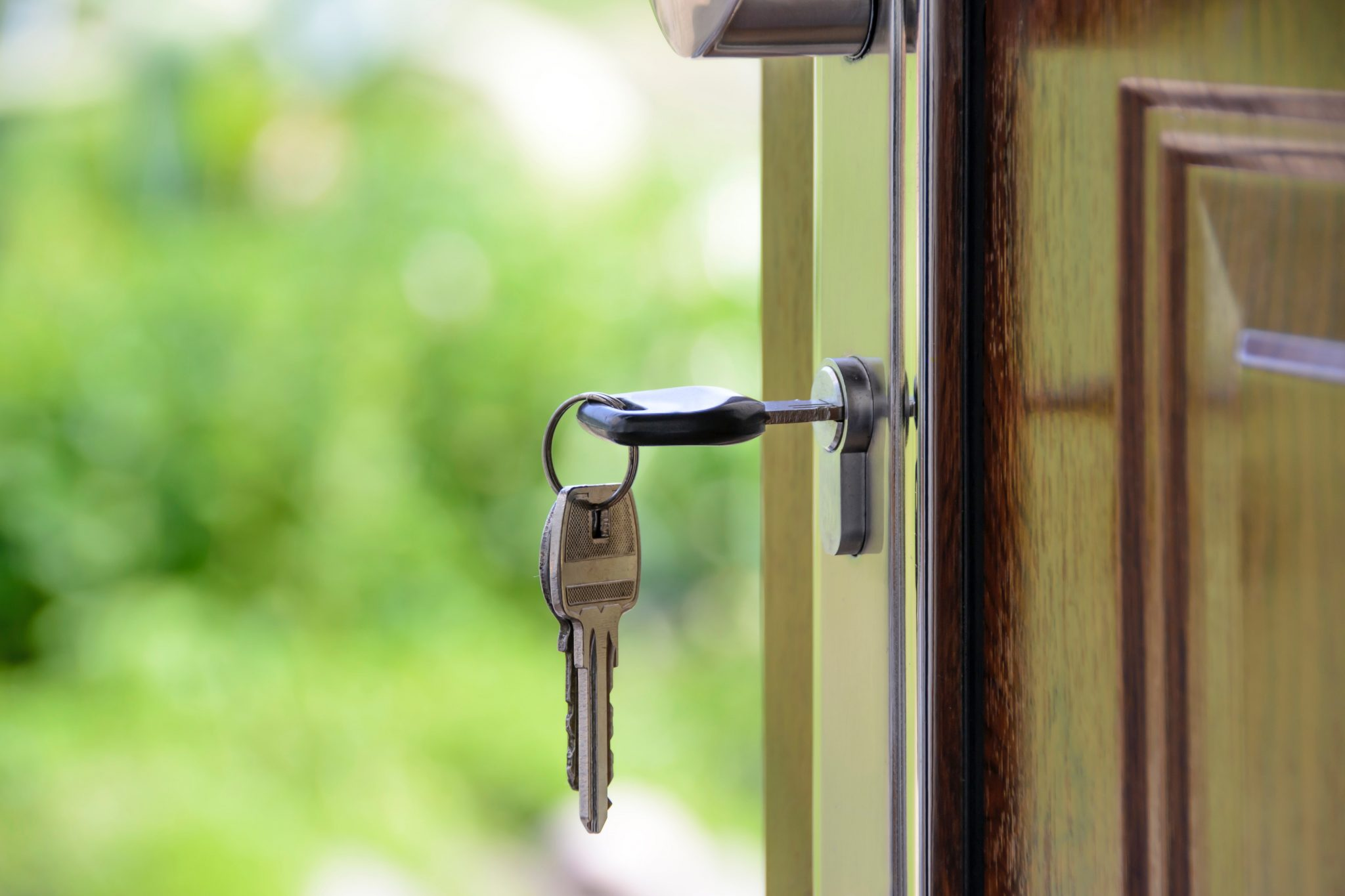 key hanging from lock on door